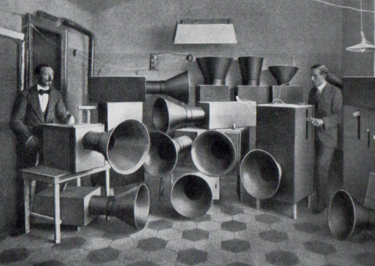 Famous picture of Luigi Russsolo with s Ugo Piatti among their own instruments - intonarumoris.